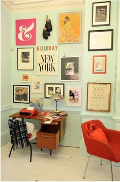 i like the red chair and the wall decor. #home