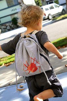 a little backpack w/ a car mat inside!