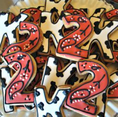 Western Cow and Bandana Print Decorated Sugar Cookies Cowgirl Cowboy Birthday Party Favors. $16.00, via Etsy.