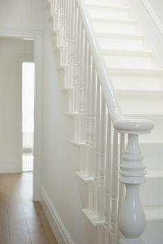 white staircase via pink wallpaper