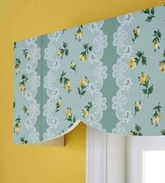girls room window idea with wallpaper on cornice board