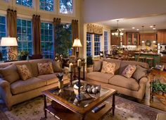 A soaring wall of windows frames this welcoming Great Room and kitchen from John Wieland Homes near Raleigh.