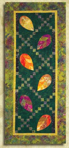 """Autumn Splendors Wallhanging or Banner Pattern by Cotton Tales Designs at KayeWood.com. 22"""" x 50"""" Runner or Banner The leaves have been paper pieced in two sections, then stitched together.  The leaves can then be appliqued by hand, or by machine onto the pieced background.  <p>Fun to make, and so colorful  <p>Nature is wonderful. http://www.kayewood.com/item/Autumn_Splendors_Wallhanging_Pattern/3415 $9.00"""