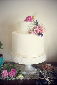 Simple fondant cake adorned with roses and lavender