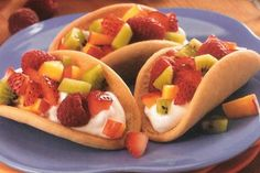 Sugar cookie tacos with fruit and cream cheese filling. So cute!