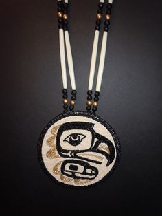 Native coastal drawing by Anthony Duenas. Beadwork by Lynnette Duenas. Eagle design