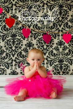 valentine baby girl.  heart backdrop. pink tutu.