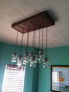 Light fixture my husband made out of Ball canning jars.