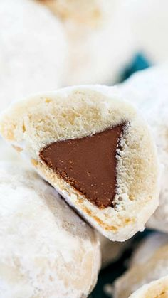 Chocolate Kiss Powder Puff Cookies ~ Easiest cookies ever with only 3 ingredients! The Kiss in the middle makes everyone smile!! So fun!!
