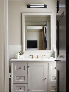 pale gray cabinets, white marble counters, brass