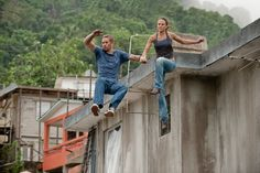 Paul Walker as Brian O'Conner and Jordana Brewster as Mia Toretto in FAST FIVE (2011).