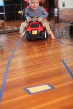 Make a very large road through the entire house using tape!