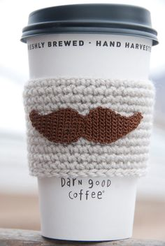 Hand crocheted coffee cosy cozy, brown mustache  on a silver gray sleeve, gift for him her. $14.00, via Etsy.