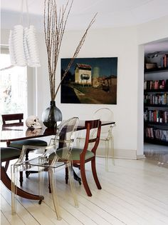 Mix 'n match dining room chairs (Philippe Stark ghost chairs and Pierre Cronje wood)