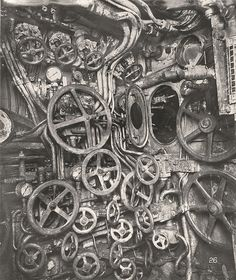 U-Boat 110, a German Submarine that was sunk and risen in 1918. This photograph shows the control room in the Submarine, including the manhole to the periscope well, hand wheels for pressure gear, valve wheels for flooding and blowing and the air pressure gauges.
