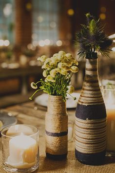 bottles wrapped with string and twine, photo by Sloan Photographers http://ruffledblog.com/glam-carondelet-house-wedding #wedding #centerpieces #weddingideas