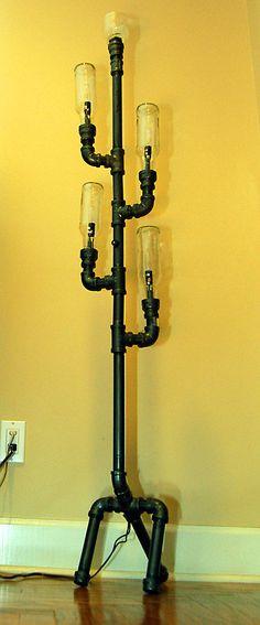 Industrial Floor Lamp, steampunk pipe lamp, recycled plumbing pipe industrial lighting. $800.00, via Etsy.