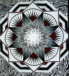 """Asilomar Lone Star"" by Nancy Calhoun in black and white with zebra prints. 2010 Viewers' Choice, Winters Outdoor Quilt Festival (California)"