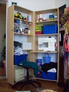 IKEA Hackers: A craft pod that hides a sewing machine.  Two Billy bookcases makes one great craft pod. Closes to hide the full shebang of crafty things. Opens up to reveal loads of storage and even space of a sewing machine.