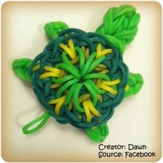 Rainbow loom turtle charm I think somebody took the kaleidoscope design and added a head and four legs. I want to try this
