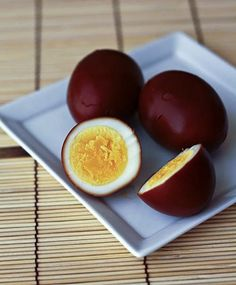 Soy Sauce Eggs (Shoyu Tamago) recipe - Shoyu tamago are eggs that have been hard boiled, peeled, and then cooked in heated soy sauce so that the egg white turns brown on the outside and the egg becomes flavored by the soy sauce. They are wonderful as snacks or as an addition to a bento (a traditional Japanese lunch in a box) because they don't need any additional seasoning.