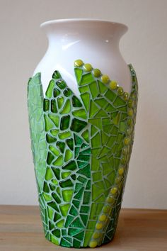 Varying shades of green mosaic on vase