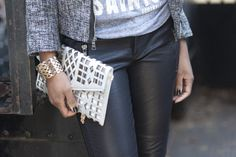 Silver clutch and leather pants from @marshalls.