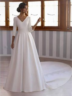 Material: Tulle Body Shape: All Sizes Silhouette: Ball Gown Train: Sweep/Brush Hemline: Floor-Length Neckline: Jewel Sleeve Length: Long Sleeves Waist: Natural Back Details: Button Embellishments: Button,Cascading Ruffles Wedding Venues: Church,Garden/Outdoor,Hall Season: All-Season *@**@*712909