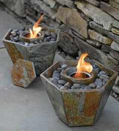 Hmmm. What if you placed a small pot/container inside a larger one, surrounded by rocks? Good DYI for outside