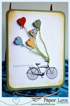 (Paper Love) Heart balloons tied to a bicycle... would be great for a Valentine!