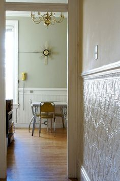 Forget wainscot, use tin tile/backsplash for below the chair rail. AWESOME.