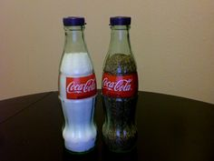 My mom and step dad gave me these salt and pepper shakers for a wedding gift.  They were made with glass coca-cola bottles!  They have a set made from glass Corona bottles, but my hubby and I aren't drinkers, so we got these cute Coca-Cola ones instead.