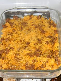 Walking Taco Casserole - Corn Chips, Ground Beef/Taco Mix and Shredded Cheese layered.  1 1/2 lb ground beef,  1 pkg taco seasoning mix,  Fritos,  Shredded Cheddar cheese.  Layer in a casserole dish in the following order: Fritos chips, taco meat mixture, shredded cheese. Repeat. Bake at 350° for about 15-20 min or until cheese is bubbly.