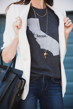 Pair graphic tees with a blazer and long necklaces for an instant chic look.
