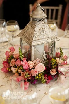 Centerpiece with lantern, candle and flowers