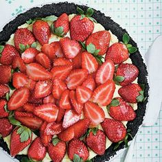 Strawberry Cream Pie | A dark-chocolate crust and jewel-bright berries brushed with jelly turn this down-home pie into company-worthy fare. | SouthernLiving.com