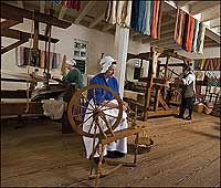 Turning fibers into cloth, weavers Sandy Gibb, Eileen Hammond, and Max Hamrick Jr. keep alive the eighteenth-century practices of the trade. fiber anim, american histori, wheel spin, spin wheel