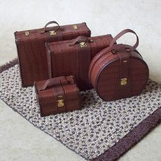1:12 Scale Miniature Luggage / 4-Piece Matching Set, looks like Exotic Reptile Leather. 1:12 Scale Miniature Luggage / 4-Piece Matching Set, looks like Exotic Reptile Leather. One of a kind. FrandMadeMinis/Etsy. Atlanta, GA.