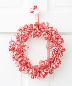 Create this pretty wreath with curling ribbon tied around an embroidery hoop. Click for more wreath inspirations!