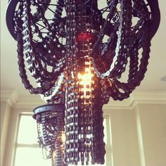 Artist Carolina Fontoura Alzaga constructs chandeliers using chains, wheels and other parts from old bicycles as part of a series she calls CONNECT.     This developing body of work draws inspiration from the aesthetics of victorian era chandeliers, DIY and Bike Culture, and follows an art tradition of utilizing non artistic materials for sculpture.