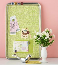 cookie sheet covered with pretty paper makes a stylish magnetic memo board!