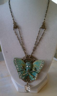 Gothic Absinthe Green Butterfly Skull Necklace by TheRustySpiderweb