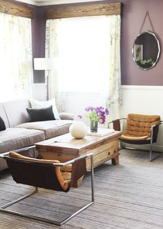 "This awesome, purple wall color is Benjamin Moore, ""Vintage Charm"". This living room was styled by Emily Henderson & the first look was the wall painted completely purple. I'd pin a picture but they're too dark looking (not a professional shot), so this will have to do. I was thinking this color would be great in your new bedroom @Leah"
