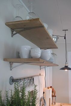 industrial style brackets in a frugal farmhouse design.