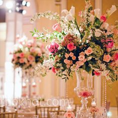 tall centerpieces with sweet pink florals and hanging crystals.