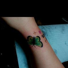 Green butterfly on my wrist