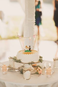 Bunting-topped wedding cake | Photography: Nessa K Photography - nessakblog.com  Read More: http://www.stylemepretty.com/2014/05/30/romantic-woodlawn-bed-breakfast-wedding/
