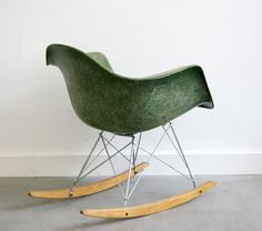 Name: RAR, Rocking Armchair Rod  Designer: Charles & Ray EAMES  Producer/year  Zenith Plastics, 1948/50. Second production. No longer in production.  Description: Armchair: fiberglas shell on rocker base, zinc plated, wood runners. Color: green, very rare! Big shockmounts.