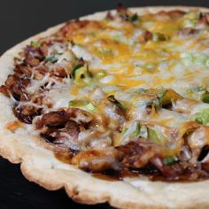 Rotisserie BBQ Chicken Pizza using the hot rotisserie chickens you can find near the front of our stores!