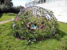 Bike Rim Garden Hideout for kids. Zip tie or wire the rims together and add creeping plants. Could possibly be done with hula hoops.